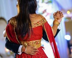 Indian bride and groom wedding dance performance