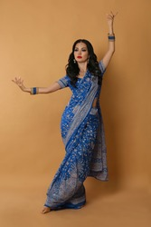 Indian bride. Beautiful arabic belly dancer in traditional costume isolated at studio background. Exotic gorgeous dancing arabian woman.