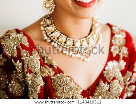 Indian bride showing gold necklace #1143410312