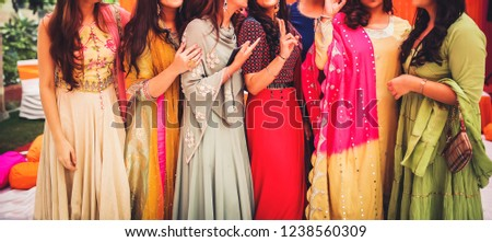 Indian bride with bridesmaids sangeet posing style Karachi, Pakistan, November 22, 2018 #1238560309