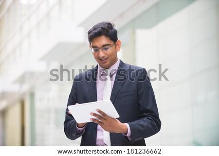indian business male with a tablet stock photo