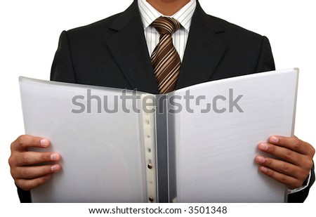 Indian business man looking at a file.