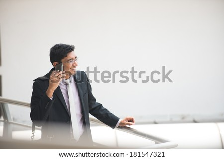 indian business man on a phone