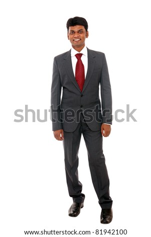 Indian business man posing to the camera on white background.