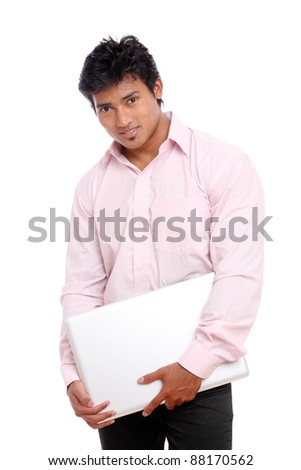 Indian business man posing with laptop on white.
