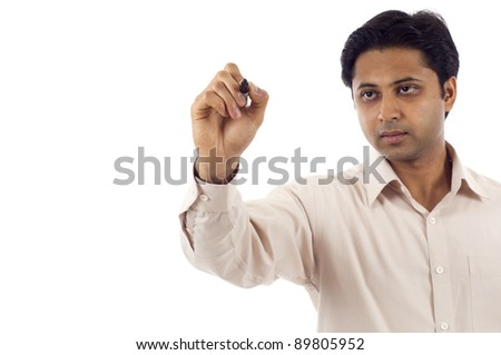 Indian business man writing on copy space, add your own text or drawing. - stock photo