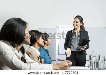 Indian business woman giving presentation with her digital tablet.