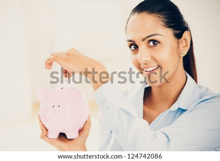 Indian business woman saving money piggy bank vintage style portrait