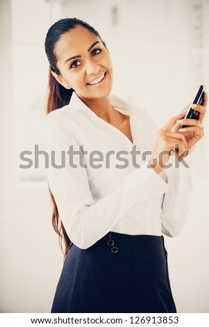 indian business woman using...