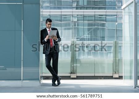 indian businessman using a...