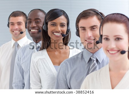 Indian businesswoman working in a call center standing in a line