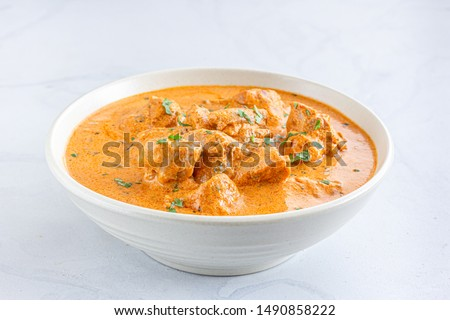 Indian Butter Chicken / Murgh Makhani in a Bowl on WHite Background Close Up Photo.