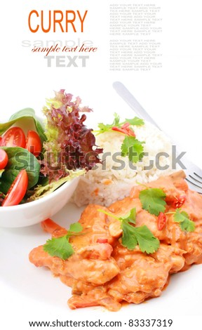 Indian butter chicken on rice and salad