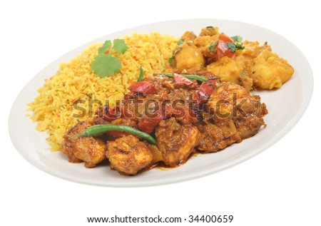 Indian chicken curry with potato curry and lemon rice