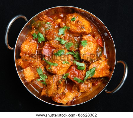 Indian chicken jalfrezi curry in a balti dish.