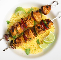 Indian chicken tikka kebabs served with pilau rice