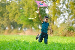 indian child playing with kite