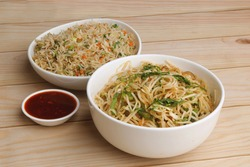 Indian Chinese combo of veg fried rice, veg noodles and sauce.