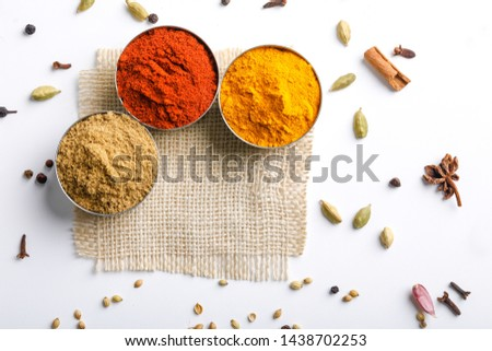 Indian Colourful Spices Red Chilli Powder, Turmeric Powder, Coriander Powder on White Background