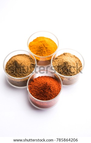Indian colourful spices red chilli, Turmeric, Coriander and Cumin powder. Served in bowls over white background. selective focus  #785864206