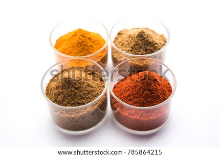 Indian colourful spices red chilli, Turmeric, Coriander and Cumin powder. Served in bowls over white background. selective focus  #785864215