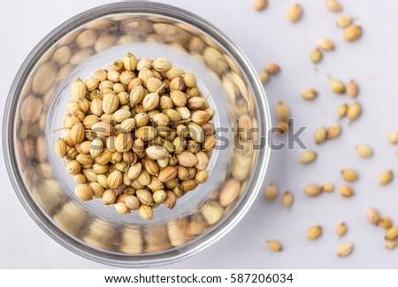 Indian Coriander Seeds #587206034