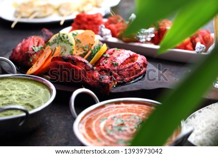 Indian cuisine, aromatic curry dishes. Colorful dishes.