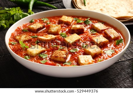 Indian cuisine -paneer butter masala curry dish,