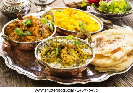 indian curries with rice and bread