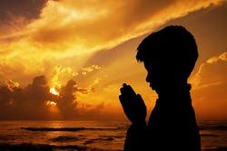 Indian Cute Boy Praying on Beach