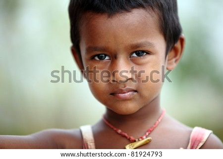 Indian cute little girl posing to the camera/