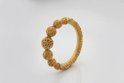 Indian designer Gold Bangles on  a white background.