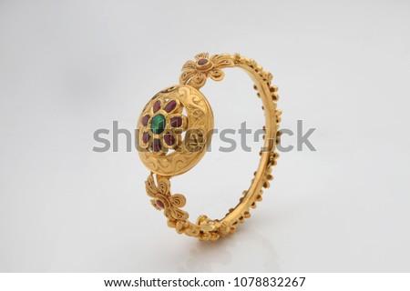 Indian designer Gold Bangles on  a white background.