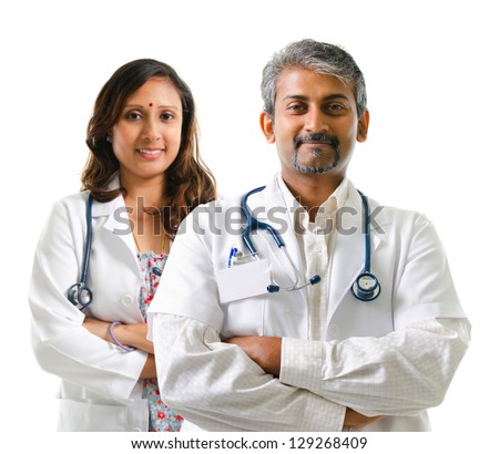 Indian doctors or medical team crossed arms standing isolated on white background