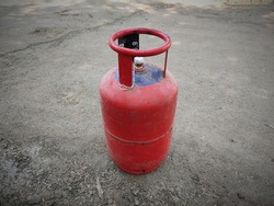 Indian Domestic LPG Gas Cylinder or Domestic Cooking gas Cylinder on land, gas cylinder on surface with space