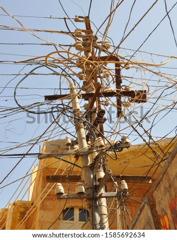 Indian electricity pole with many wires