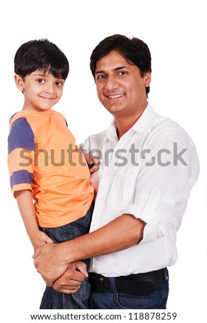 Indian family, father holding the son in his lap