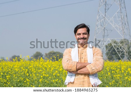 Indian farmer standing in agricultural field