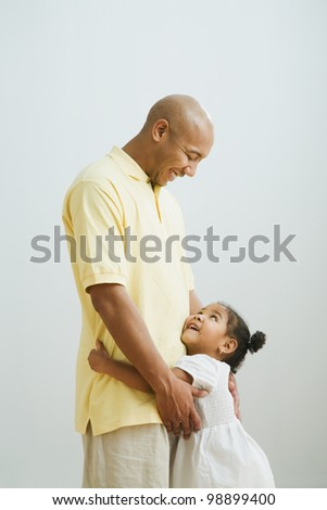Indian father and daughter hugging