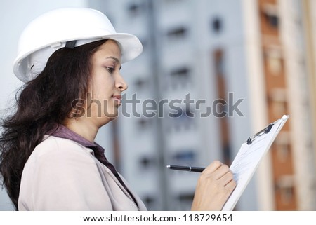 Indian female construction engineer at work place