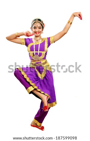 Indian female performing Bharathanatyam doing the action of depicting Lord Ganesha in violet color costumes