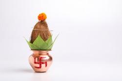 Indian festival akshaya tritiya concept : Decorative kalash with coconut and leaf with floral decoration