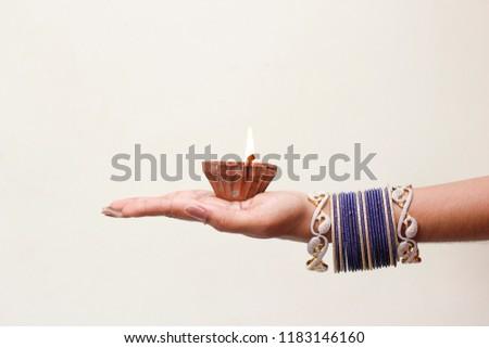 Indian Festival Diwali, lamp in hand - Shutterstock ID 1183146160