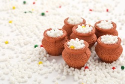 Indian festival makar sankranti concept : Tilgul in small bowl. Tilgul is a colourful sesame candy coated with sesame seeds; in Maharashtra people exchange tilgul on Sankranti