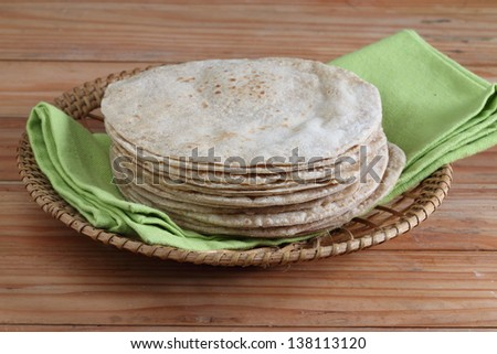 Indian flat-bread called chapati in basket