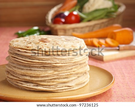 Indian flatbread called chapati  (Selective Focus, Focus on the front chapatis)