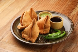Indian food Samosa,A samosa is a deep fried or baked pastry with a savoury filling, such as spiced potatoes, onions, peas