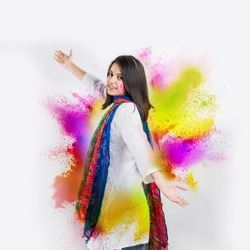 indian girl celebrating holi festival with colour splash