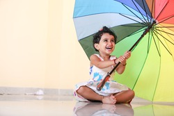 indian girl child with umbrella