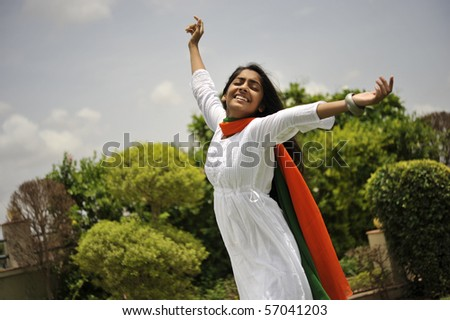 indian girl expressing freedom wearing tri color